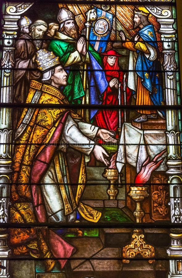 Colorful stained glass window in St Louis cathedral in New Orleans. New Orleans, Louisiana - February 6, 2017: Religious colorful stained glass window in St stock photography