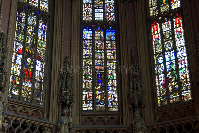 Colorful stained-glass windows, St James Church, Liege. Belgium, Walloon, province and city Liege: inside the medieval Saint James church, a former abbey and royalty free stock photo