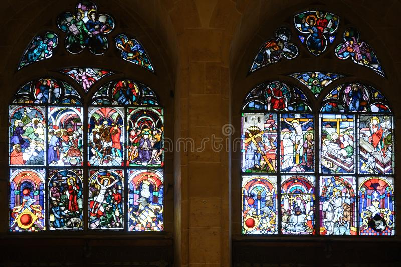 Colorful stained-glass windows in Ulm Minster, Ulm Cathedral, Ulmer Muenster, on Romantic Street in Germany. Colorful church Windows showing life, death and royalty free stock image