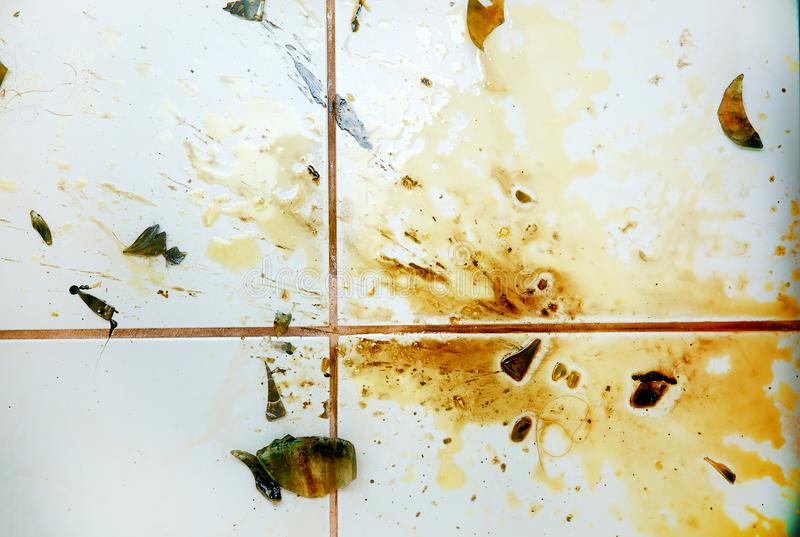 Colorful stains and broken glass on white bathroom tiles. Colorful stains and broken glass on white bathroom tiles royalty free stock photo