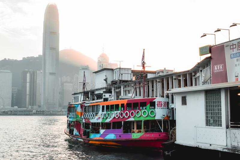 Colorful Star Ferry waiting in a dock for boarding in the Victoria Harbor in Hong Kong China stock photography