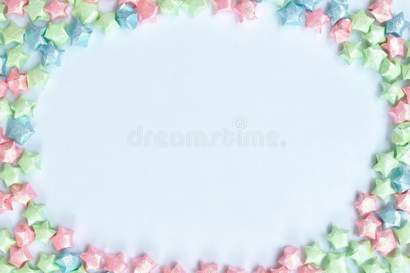 Colorful star paper arraigning circle copy space on white background stock photos