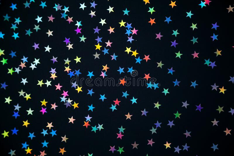 Colorful stars on a black background royalty free stock photos
