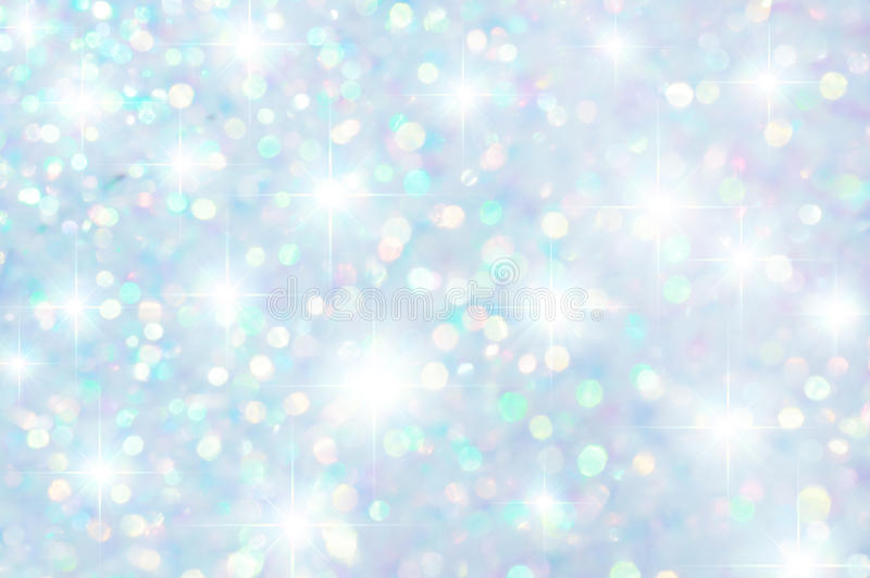 Colorful Stars and bokeh Background. Muted background composed of iridescent small light spots and stars