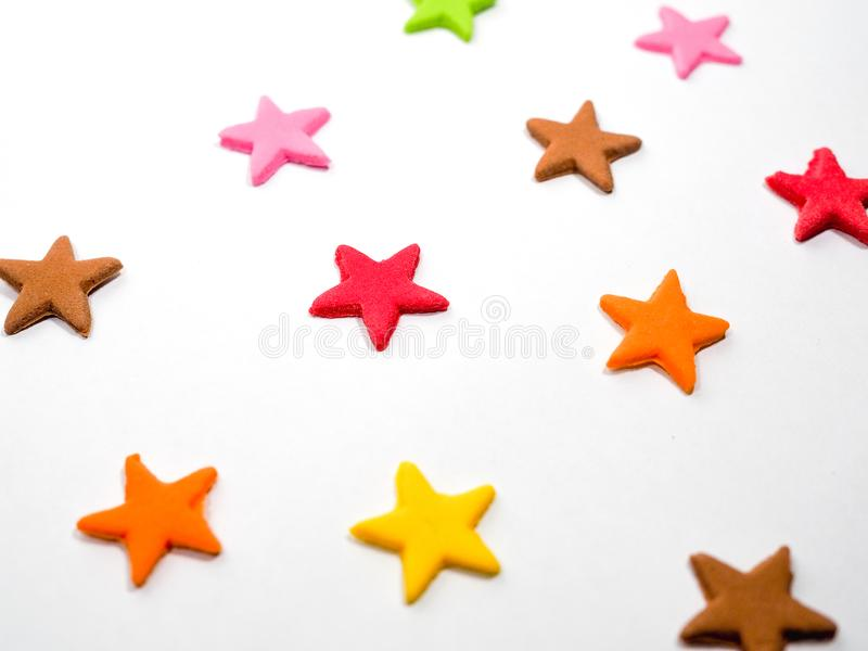 Colorful stars shape candy sugar on white. Background royalty free stock photography