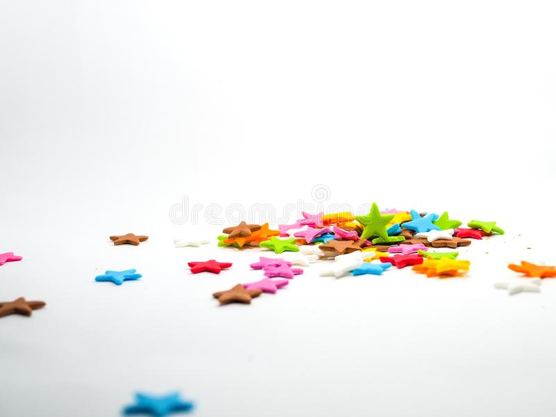 Colorful stars shape candy sugar on white. Background stock photography