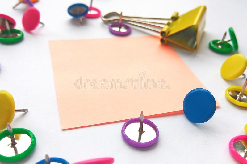 School and office supplies paper clips, pins, notes, stickers on white background. Colorful stationary, back to school, office, business and education concept stock image