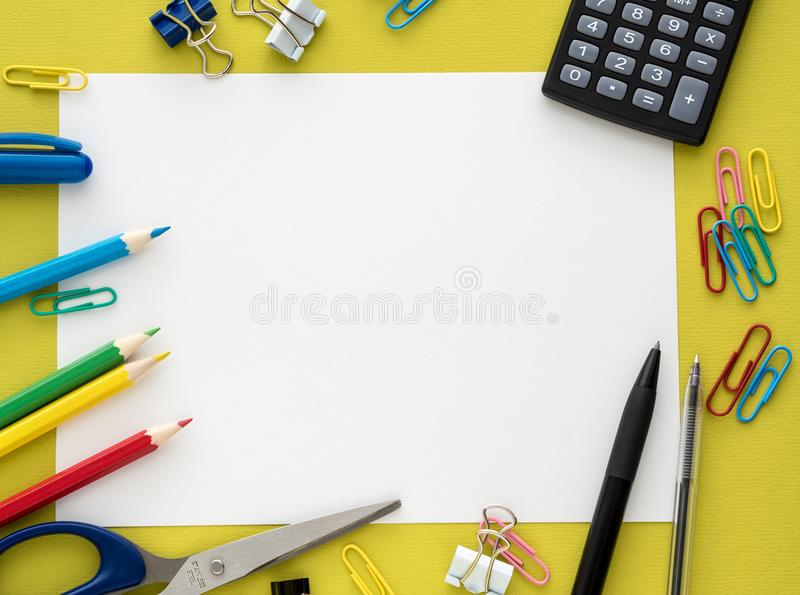 Colorful stationery on yelow background royalty free stock image