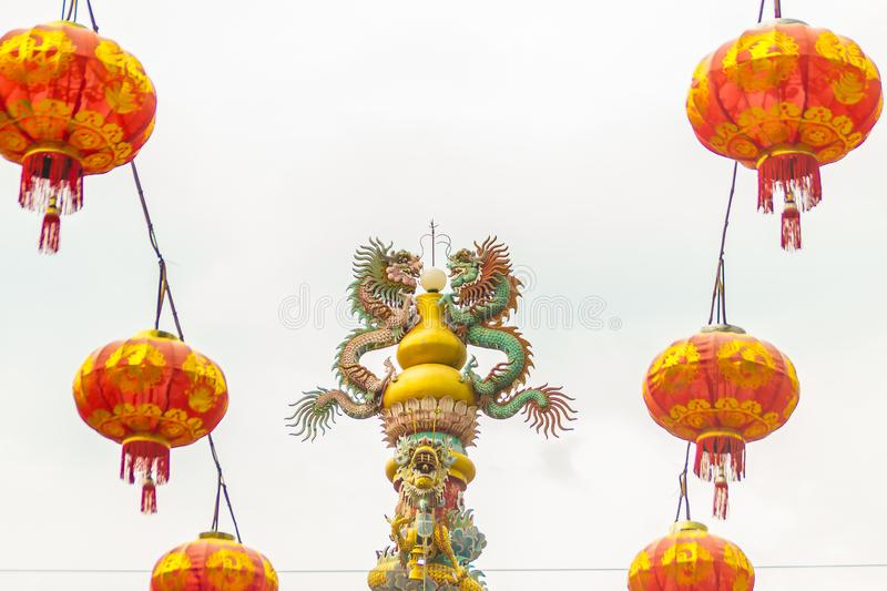 Colorful statue of Chinese dragon wrapped around the pillar. Beautiful statue of dragon carved around temple pole in Chinese royalty free stock images