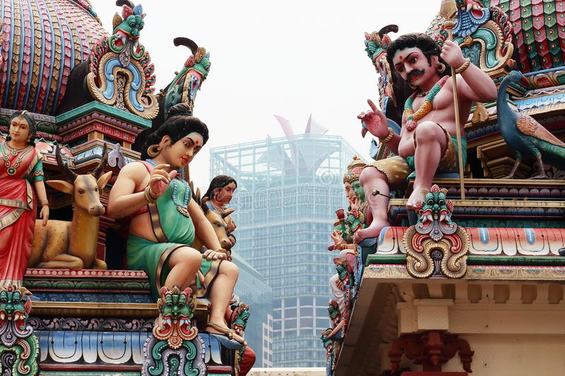 Colorful statues placed over the roof of Sri Mariamman Temple, the oldest hindu temple in Singapore stock photo