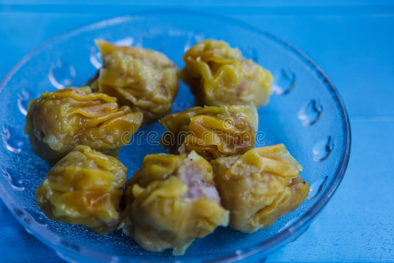 Colorful of Steamed prawn timsum. On blue table stock photography