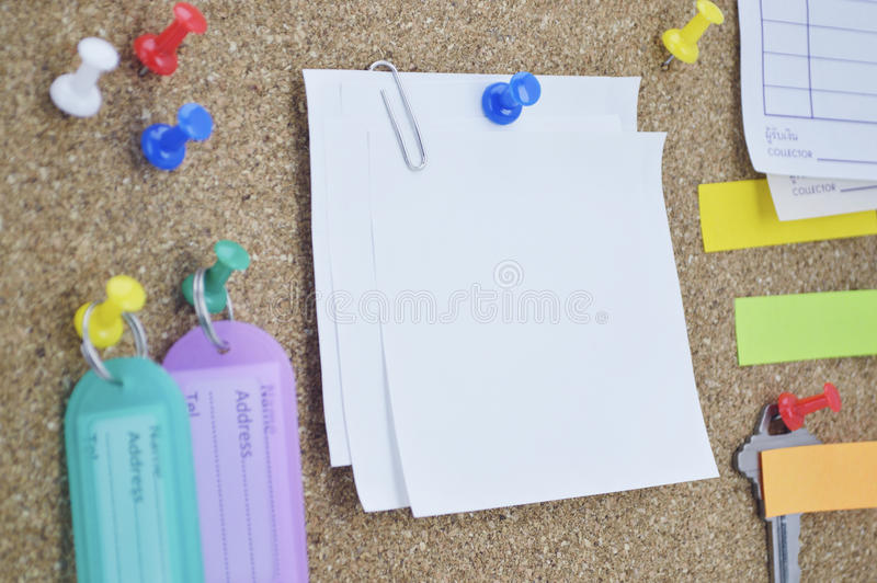 Colorful sticky notes, pin and tag name on cork board royalty free stock photo