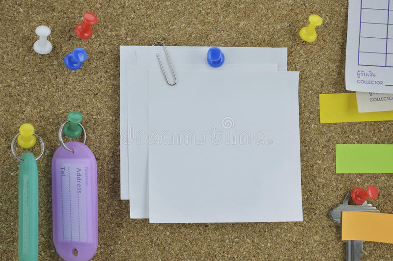 Colorful sticky notes, pin and tag name on cork board stock photos