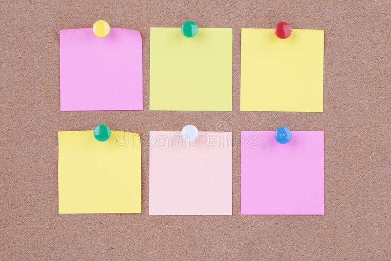 Colorful sticky paper note on the cork board.  stock images
