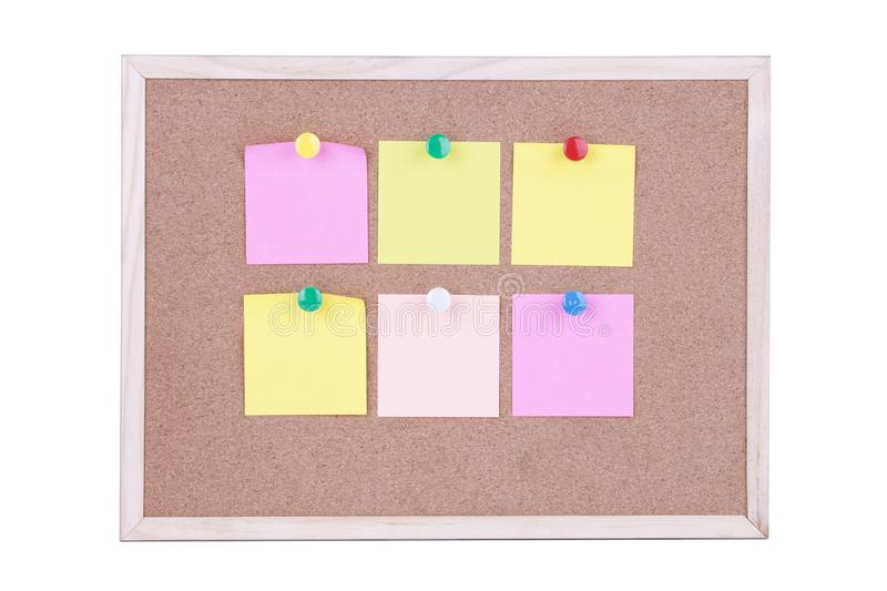 Colorful sticky paper note on the cork board,white background.  stock photos