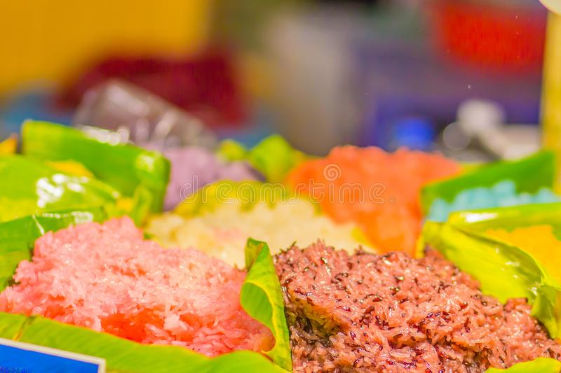 Colorful sticky rice in coconut milk for eat with ripe mango. Mango sticky rice is a traditional Thai dessert made with glutinous stock photos
