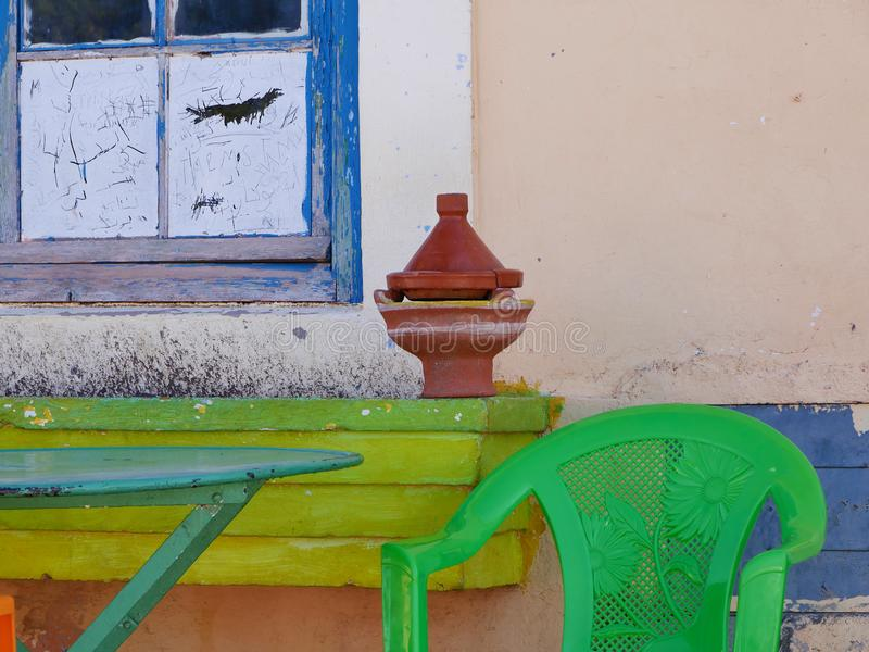 Colorful stillife in africa. Romantic colorful table chair dinner lunch stillife africa marocco outdoor stock image