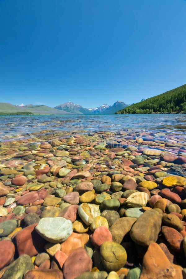 Colorful stone in lake mcdonald stock photo