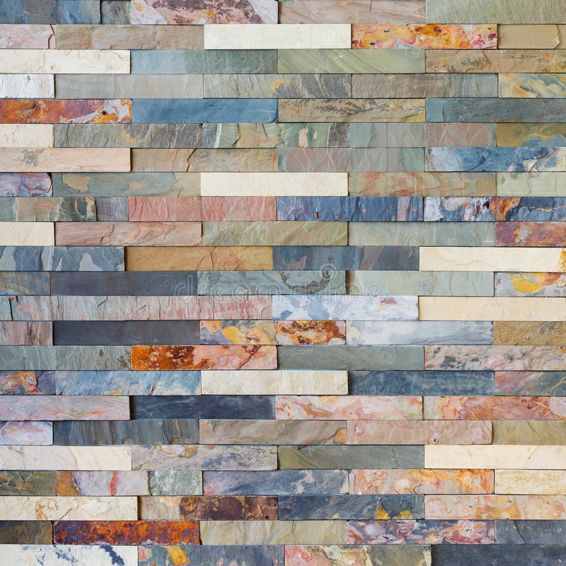 Colorful stone wall tiles. Close up colorful stone wall tiles decoration in living room royalty free stock images