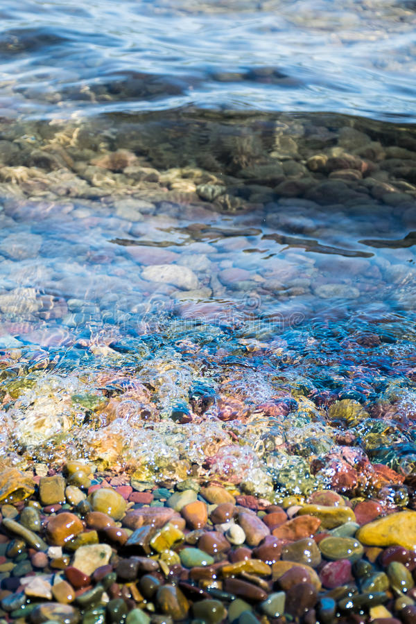 Colorful stone with water in Glacier national park royalty free stock images