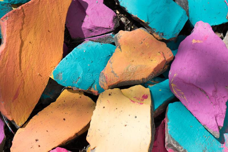 Colorful stones background. Bright colors of rocks. Blue, orange, pink color background. Outdoor colorful stones stock images