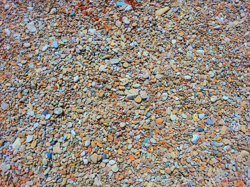 Colorful stones scattered on ground. royalty free stock photography