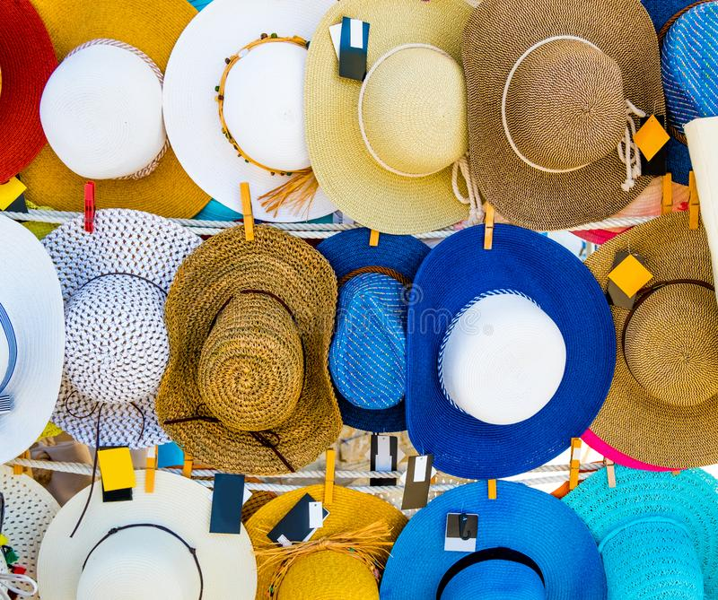 Straw summer hats on market stall outdoor royalty free stock image