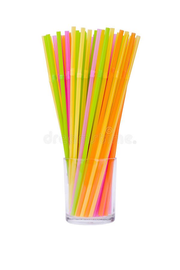Colorful straws. Arranged colorful straws in a glass stock photo