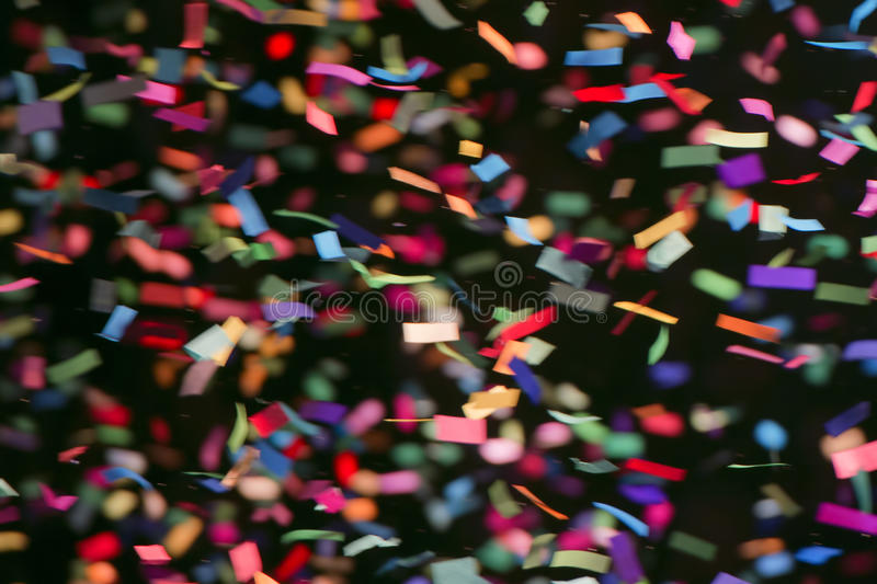 Colorful streamers on black background royalty free stock photography