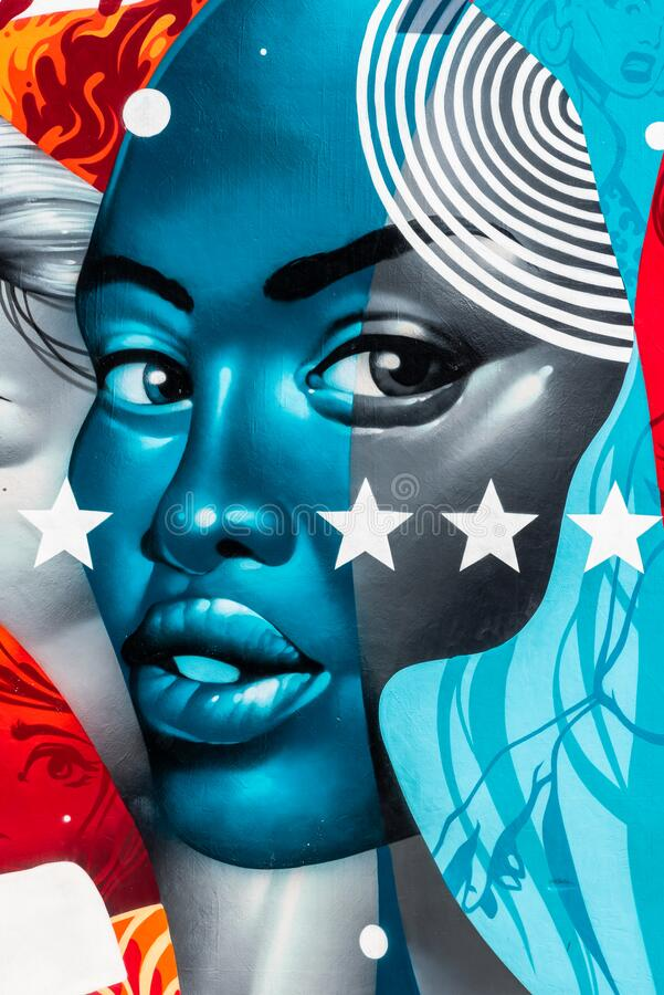 Free Colorful Street Art Graffiti Mural Showing Face Of Beautiful Bold Afro American Woman And The Stars Of The American Flag Stock Image - 178671581
