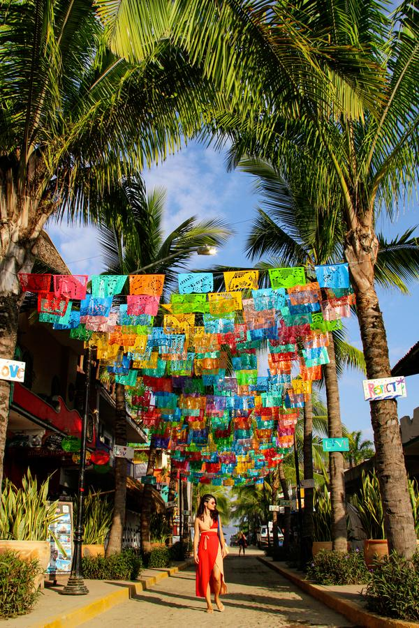Colorful street with palm trees in Sayulita, Mexico royalty free stock images