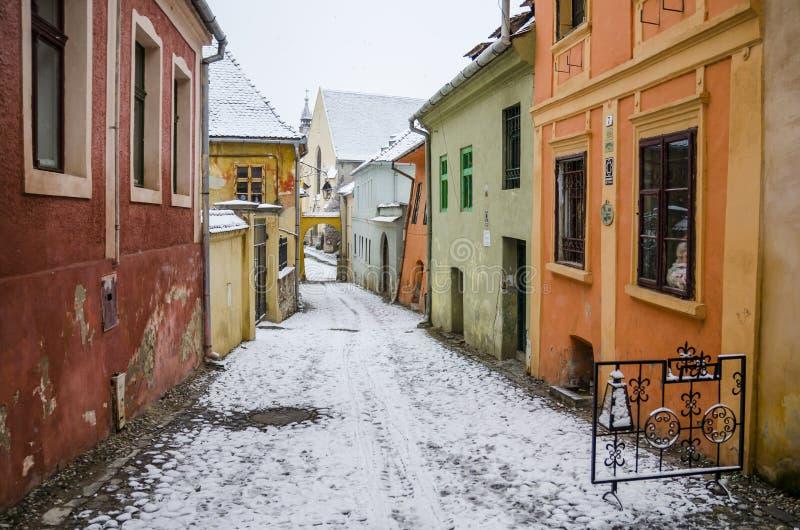 Colorful street in Sighisoara, Romania stock photos