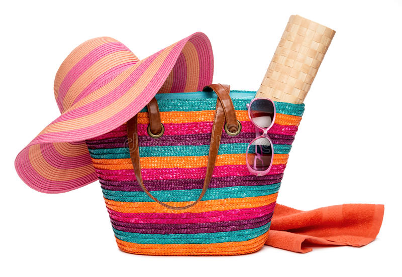 Colorful striped beach bag with a hat sun mat towel and sunglasses stock images