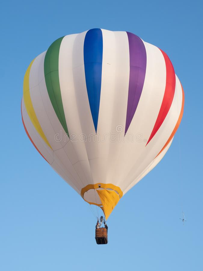 A Colorful Striped Hot Air Balloon in Flight at July 2018 Big Sk stock image