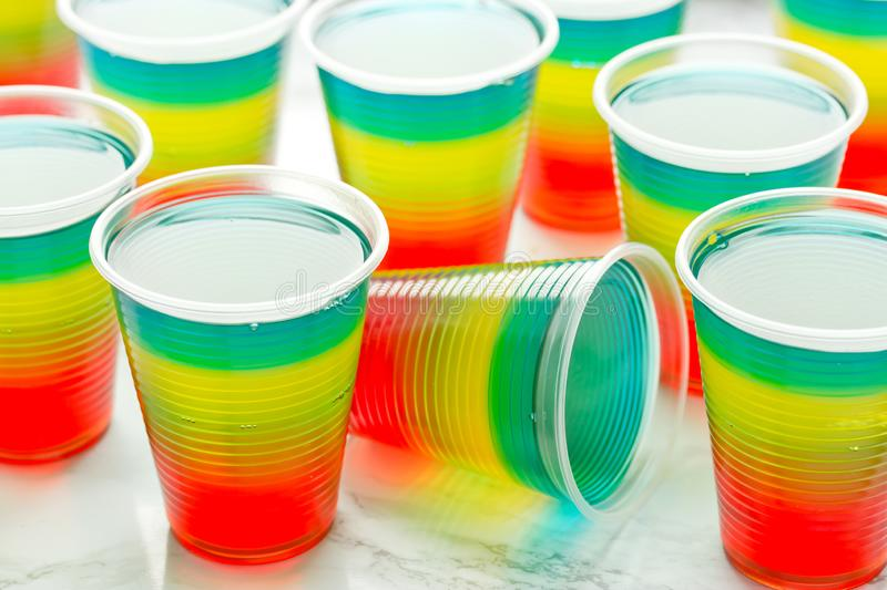 Colorful striped jelly on white background stock images