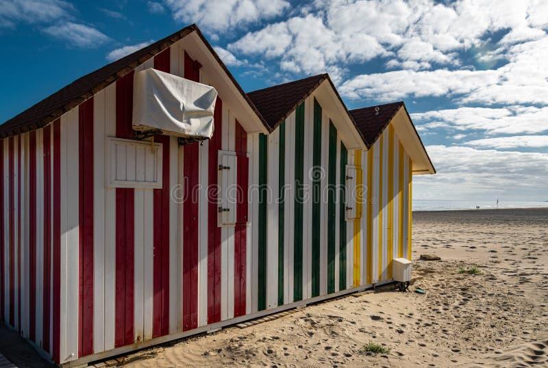 Colorful stripy beach huts. Colorful stripy beach huts on Playa de San Juan beach, Alicante, Spain stock photos