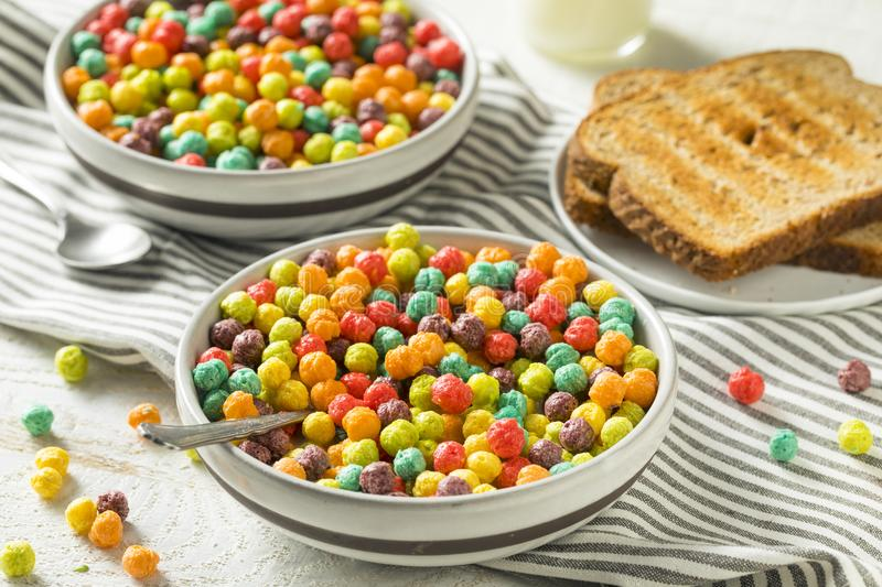 Colorful Sugar Breakfast Cereal. With Milk and Toast royalty free stock photo
