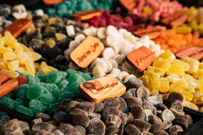 Colorful sugar sweets gums and jelly beans on market royalty free stock photography