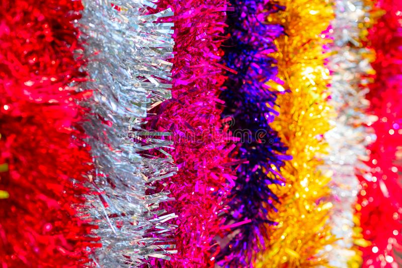 Colorful Sukkot or Sukkos or Christmas tinsel. New year`s fluffy gold, purple, silver, yellow, pink tinsel. stock image