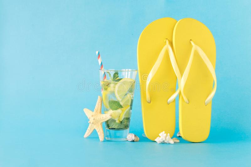 Colorful summer background. Summer cocktail flip flops starfish royalty free stock image