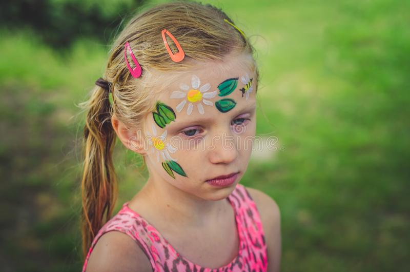Colorful summer face painting royalty free stock image