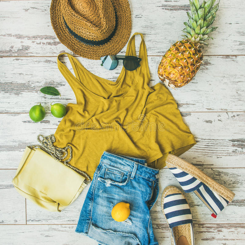 Colorful summer fashion outfit flat-lay over pastel background, square crop royalty free stock photos