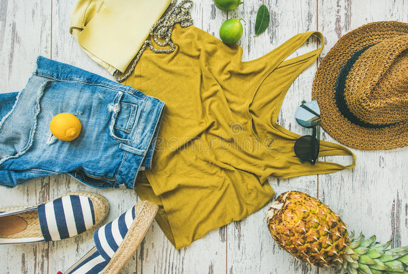 Colorful summer fashion outfit flat-lay over pastel background, top view stock photos