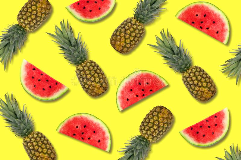 Summer fruit pattern of pineapples and watermelon slices on a yellow background stock photography