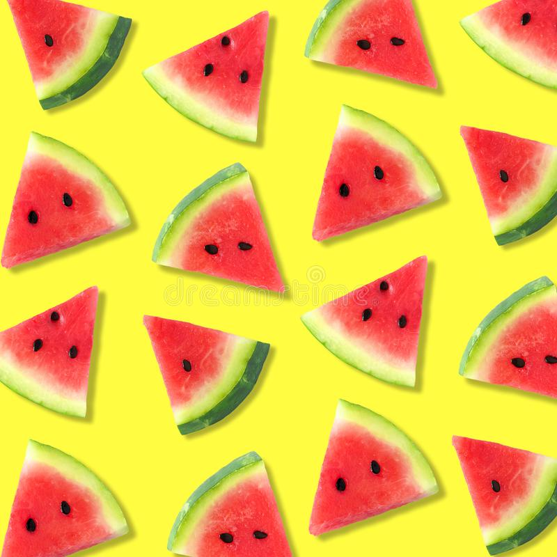 Watermelon slice summer fruit pattern on a bright yellow background. Colorful summer fruit pattern of watermelon slices on a bright yellow background royalty free stock images