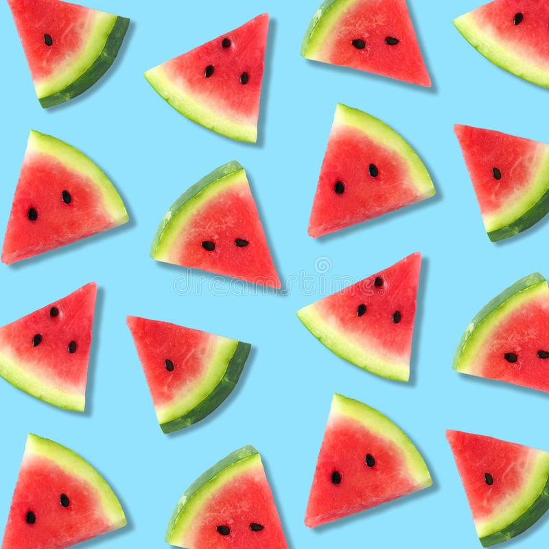 Watermelon slice summer fruit pattern on a pastel blue background. Colorful summer fruit pattern of watermelon slices on a pastel blue background stock photos