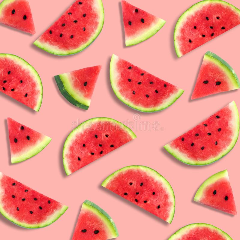 Watermelon slice summer fruit pattern on a pastel pink background. Colorful summer fruit pattern of watermelon slices on a pastel pink background royalty free stock images