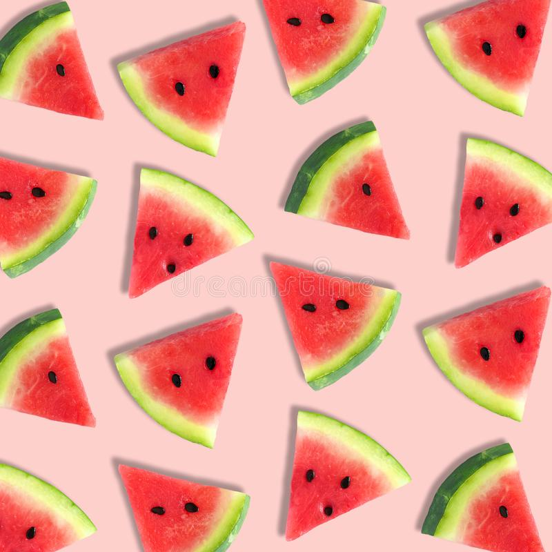 Watermelon slice summer fruit pattern on a soft pink background. Colorful summer fruit pattern of watermelon slices on a soft pink background royalty free stock images
