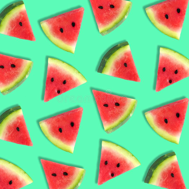 Watermelon slice summer fruit pattern on a teal green background. Colorful summer fruit pattern of watermelon slices on a teal green background royalty free stock images