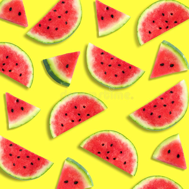 Watermelon slice summer fruit pattern on a vibrant yellow background. Colorful summer fruit pattern of watermelon slices on a vibrant yellow background stock photo